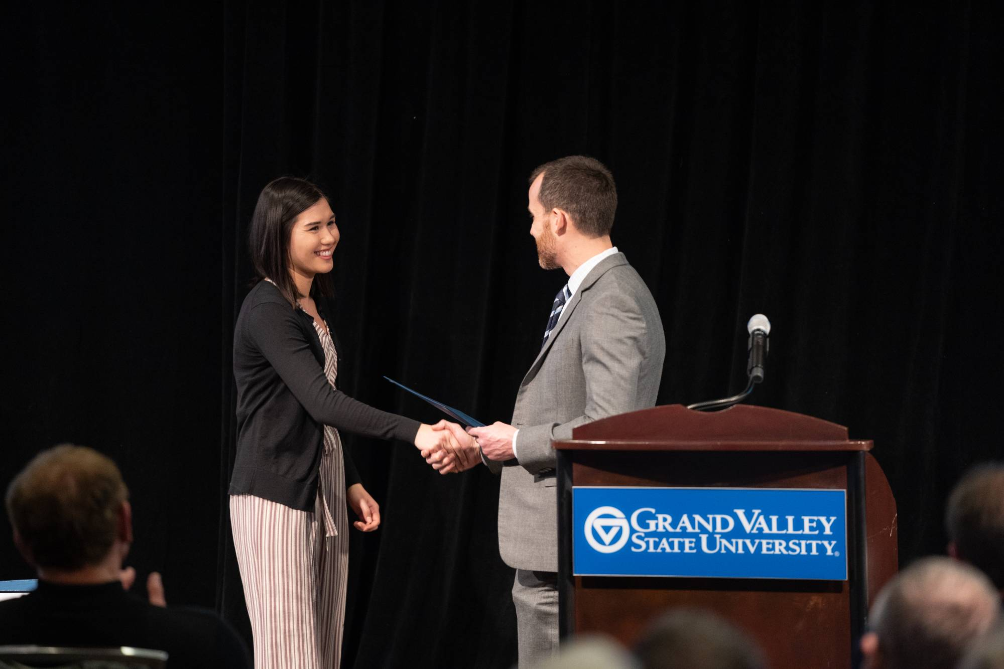 Professor Cataldo congratulating Julia Arhns for winning this year's award for Outstanding Leadership and Service.